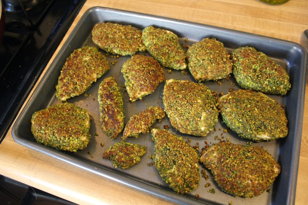 cooked gluten-free pistachio crusted chicken on a sheet pan