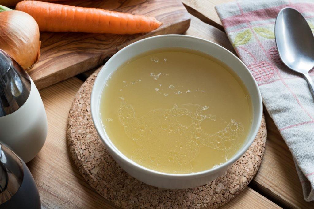 Chicken bone broth in bowl