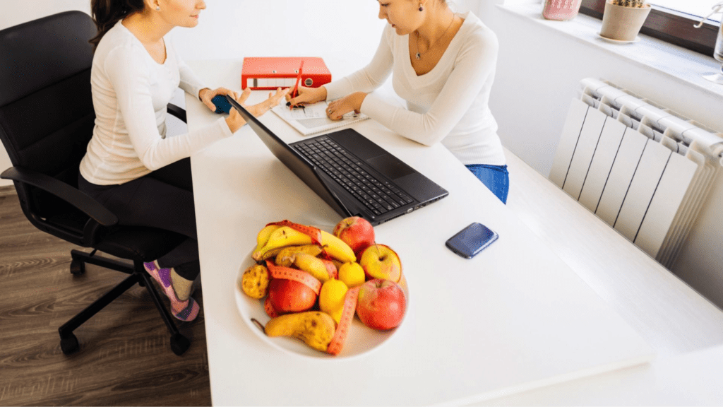 woman in nutritionist office getting diagnosed with food allergy