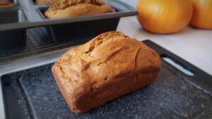 loaf of gluten free pumpkin bread on cutting board