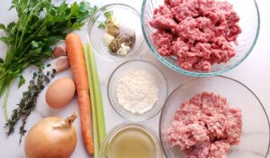 Meatloaf Ingredients in bowls assembled on marble kitchen counter
