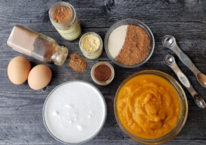 the ingredients for pumpkin pie filling in glass bowls