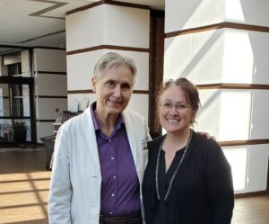 Myself standing with Dr Terry Wahls at a hotel lobby