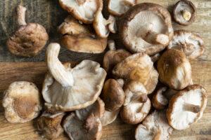 fresh shitake mushrooms on cutting board for liver pate recipe