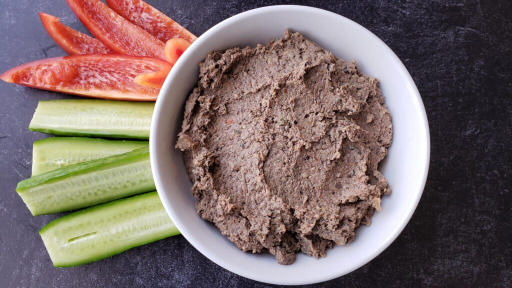 bowl of chicken and mushroom liver pate with peppers and cucumber